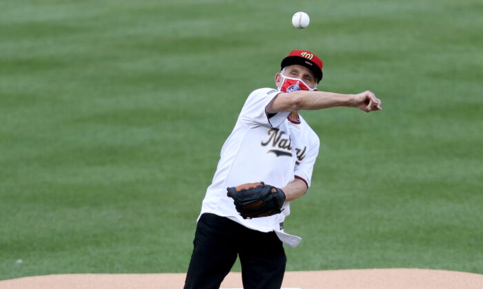 Dr. Anthony Fauci, director of the National Institute of Allergy and Infectious Diseases throws out the ceremonial first pitch prior to the game between the New York Yankees and the Washington Nationals at Nationals Park in Washington on July 23, 2020. (Rob Carr/Getty Images)
