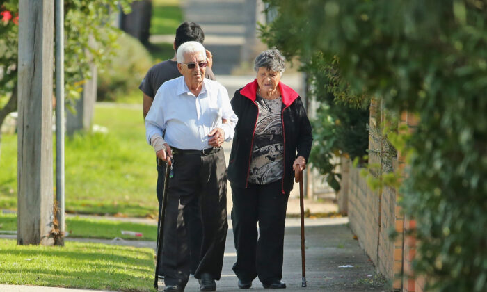An elderly couple walk down the street on May 13, 2014 in Melbourne, Australia. (Photo by Scott Barbour/Getty Images)