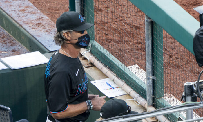 Miami Marlins' manager Don Mattingly looks out from the dugout during the eighth inning of a baseball game against the Philadelphia Phillies, in Philadelphia, Pa., on, July 25, 2020. (Chris Szagola/AP Photo)