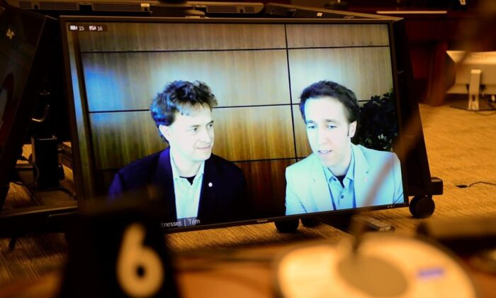 Marc Kielburger, screen left, and Craig Kielburger, screen right, appear as witnesses via videoconference during a House of Commons finance committee in the Wellington Building in Ottawa on July 28, 2020. The committee is looking into Government Spending, WE Charity and the Canada Student Service Grant. (Sean Kilpatrick/The Canadian Press)