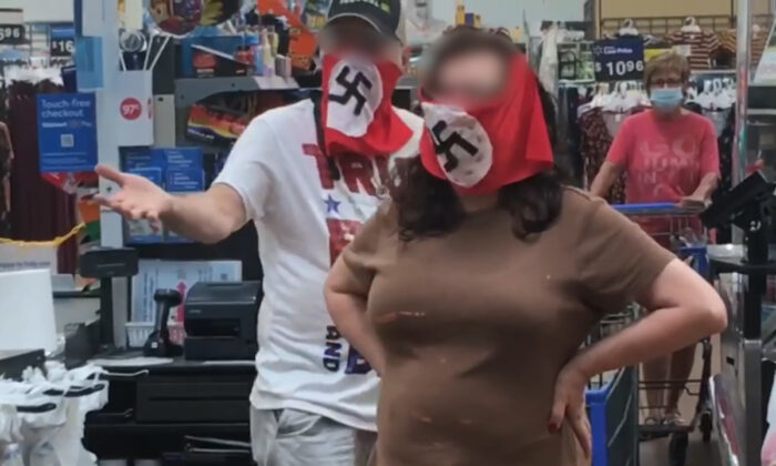 A couple wearing swastika masks is seen in a Walmart store in Minnesota in an undated photo. (Courtesy of Raphaela Mueller/Facebook)