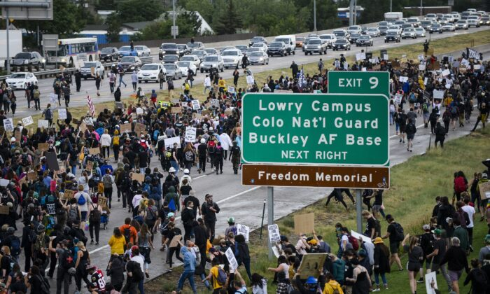 People shut down I-225 to protest the death of Elijah McClain in Aurora, Colo., on July 25, 2020. (Michael Ciaglo/Getty Images)