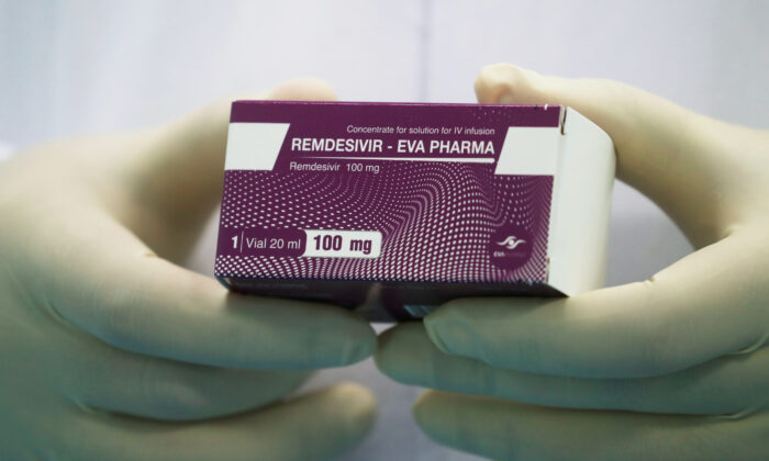 "A lab technicians holds the coronavirus disease (COVID-19) treatment drug ""Remdesivir"" at Eva Pharma Facility in Cairo, Egypt, on June 25, 2020. (Amr Abdallah Dalsh/Reuters)"