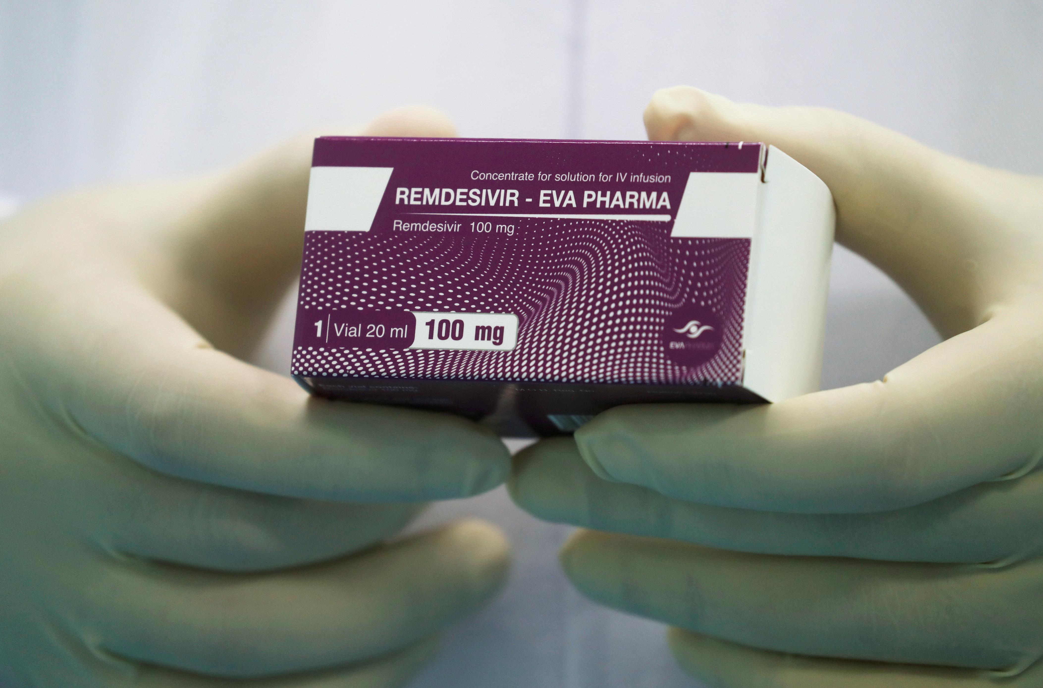 "A lab technicians holds the coronavirus disease (COVID-19) treatment drug ""Remdesivir""-1"