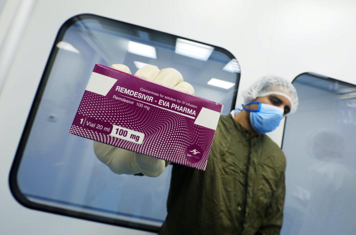 "A lab technicians holds the coronavirus disease (COVID-19) treatment drug ""Remdesivir"""