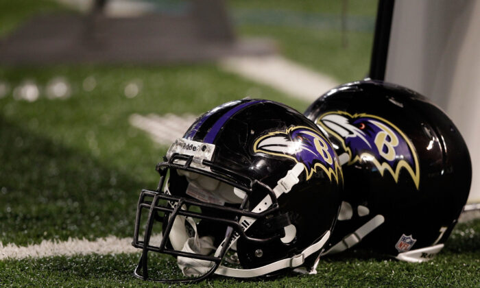 A pair of Baltimore Ravens helmets sit on the sidelines during the Ravens game against the Washington Redskins at M&T Bank Stadium  in Baltimore, Md., on August 25, 2011. (Rob Carr/Getty Images)
