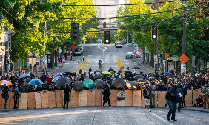 Demonstrators use shields while blocking an intersection near the Seattle Police East Precinct during protests in Seattle on July 26, 2020 in Seattle, Washington. (David Ryder/Getty Images)
