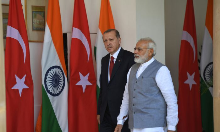 Indian Prime Minister Narendra Modi (R) walks with Turkish President Recep Tayyip Erdogan prior to a meeting and exchange of agreements in New Delhi on May 1, 2017. (PRAKASH SINGH/AFP via Getty Images)