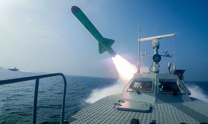 A Revolutionary Guard's speedboat fires a missile during a military exercise in Iran on July 28, 2020. (Sepahnews via AP)