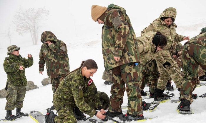 Cpl. Brenna Baverstock of the Winter Mobile Training Team conducts a snowshoe lesson for the soldiers of the Lebanon Border Regiment in the Bcharre region of Lebanon, on February 17, 2020. Canada's war against the Islamic State of Iraq and the Levant has quietly entered a new phase, resulting in plans to keep fewer troops in the Middle East even after the COVID-19 pandemic passes. (The Canadian Press/HO-Department of National Defence-Cpl. Nicolas Alonso)