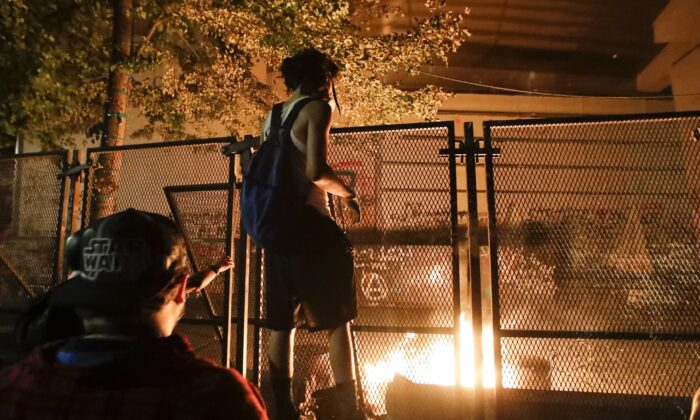 Rioters light a fire at the Mark O. Hatfield Courthouse in Portland, Ore., on July 27, 2020. (Marcio Jose Sanchez/AP Photo)