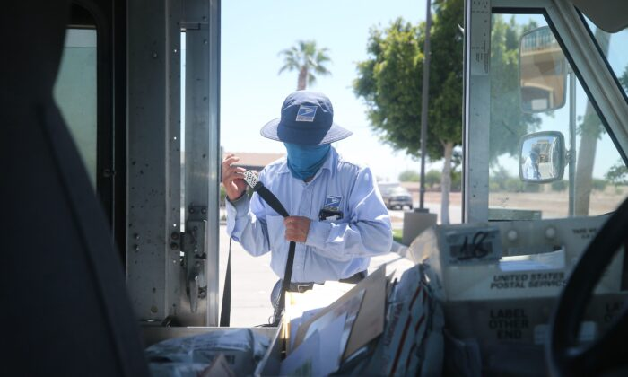A USPS postal worker wears a face mask amid the COVID-19 pandemic in El Centro, Calif., on July 21, 2020. (Mario Tama/Getty Images)