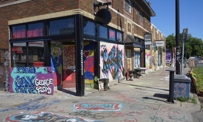 Businesses that are still closed after riots and looting followed by the death of George Floyd in Minneapolis, Minn., on July 27, 2020. (Meiling Lee/The Epoch Times)