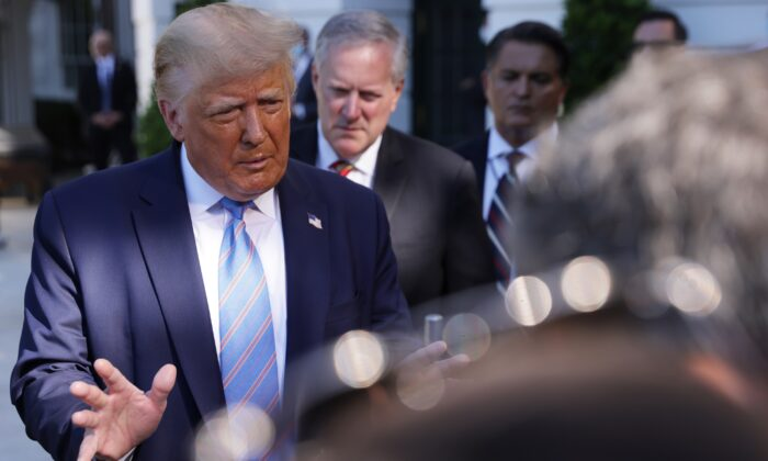 President Donald Trump speaks as White House chief of staff Mark Meadows (C) listens outside the White House on July 29, 2020. (Alex Wong/Getty Images)
