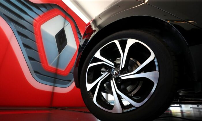 A Renault car is seen in a show room at a Renault carmaker dealer, amid the coronavirus disease (COVID-19) outbreak in Sint-Pieters-Leeuw, Belgium, on May 29, 2020. (Yves Herman/Reuters)
