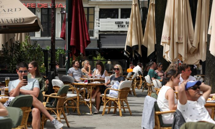 Customers enjoy their drinks at the newly reopened cafes on Leidseplein Square, as Netherlands eases some of the lockdown measures put in place during the (COVID-19) outbreak, in Amsterdam, Netherlands, on June 1, 2020. (Eva Plevier/File Photo/Reuters)