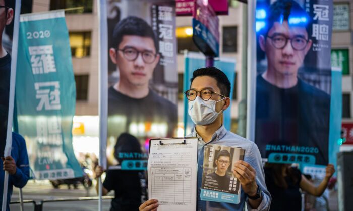 Member of the pro-democracy political organization Demosisto and disqualified lawmaker, Nathan Law, (C), speaks to reporters in Hong Kong, on June 19, 2020. (Anthony Wallace/AFP via Getty Images)