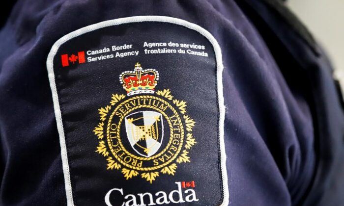 A Canada Border Services Agency (CBSA) patch is seen on an officer in Calgary, Alta., on Aug. 1, 2019. (The Canadian Press/Jeff McIntosh)