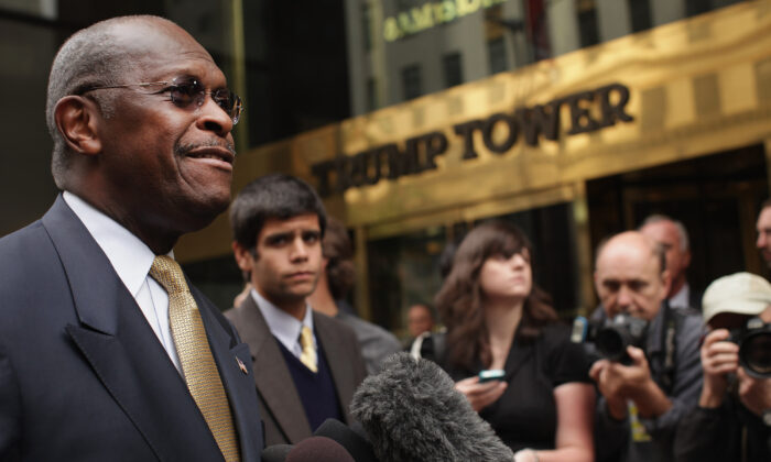 Republican presidential candidate Herman Cain speaks to the media outside of Trump Towers before a scheduled appearance with real estate mogul Donald Trump in New York City, N.Y., on Oct. 3, 2011. (Spencer Platt/Getty Images)