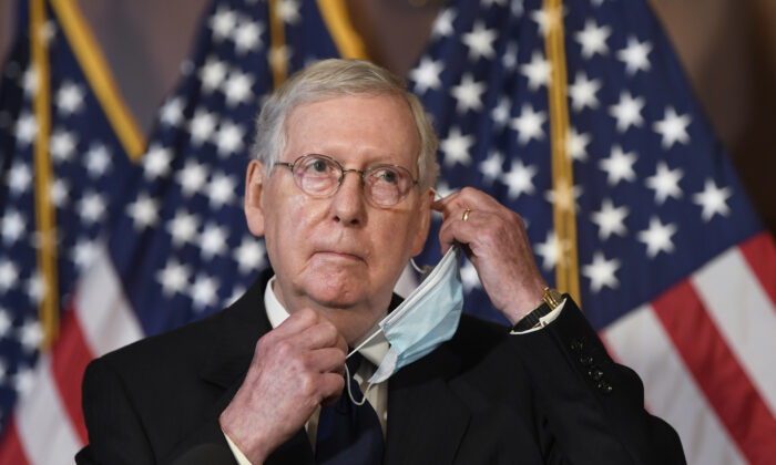 Senate Majority Leader Mitch McConnell (R-Ky.) adjusts his mask during a news conference on Capitol Hill in Washington on July 27, 2020. (Susan Walsh/AP Photo)