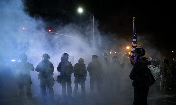 Federal law enforcement dispense tear gas as they confront demonstrators in Portland, Ore., on July 29, 2020. (Alisha Jucevic/AFP via Getty Images)
