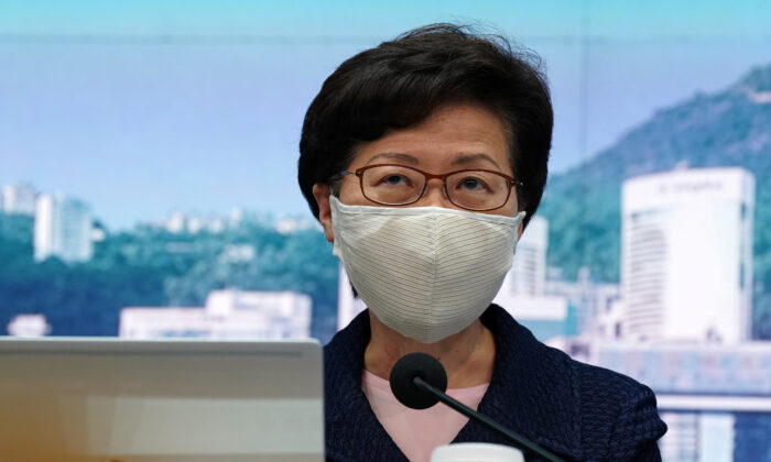 Hong Kong Chief Executive Carrie Lam, wearing a face mask following the coronavirus disease (COVID-19) outbreak, attends a news conference in Hong Kong, China on July 31, 2020. (Lam Yik/Reuters)