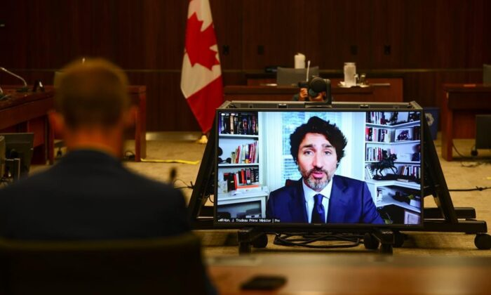 Prime Minister Justin Trudeau appears as a witness via videoconference during a House of Commons finance committee in the Wellington Building, on July 30, 2020. (The Canadian Press/Sean Kilpatrick)