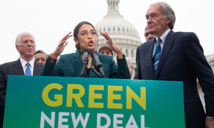 U.S. Rep. Alexandria Ocasio-Cortez (D-N.Y.) and U.S. Sen. Ed Markey (D-Mass.) (R) speak during a press conference to announce Green New Deal legislation, outside the U.S. Capitol in Washington on Feb. 7, 2019. (Saul Loeb/AFP via Getty Images)