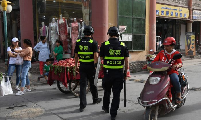 This photo taken on June 4, 2019 shows police officers patrolling in Kashgar, in China's western Xinjiang region. (Greg Baker/AFP via Getty Images)