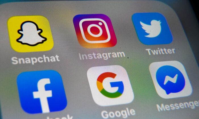 The logo of mobile app Instagram, Snapchat, Twitter, Facebook, Google, and Messenger are displayed on a tablet in Lille, France, on Oct. 1, 2019. (Denis Charlet /Getty Images)
