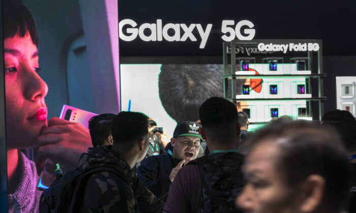 People look at 5G Samsung products during the 2020 Consumer Electronics Show (CES) in Las Vegas, Nev., on Jan. 8, 2020. (David McNew/AFP via Getty Images)