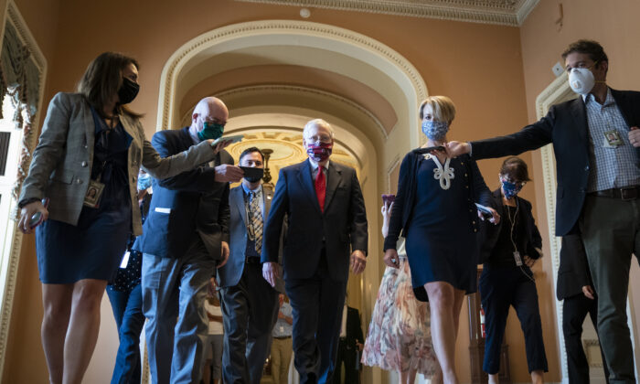 Senate Majority Leader Mitch McConnell (R-KY) is swarmed by reporters as he leaves the Senate floor in Washington, on July 30, 2020. (Drew Angerer/Getty Images)