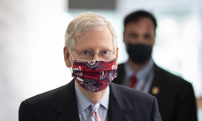 Senate Majority Leader Mitch McConnell (R-Ky.) arrives at a Senate Republican policy meeting in Washington, on July 28, 2020. (Drew Angerer/Getty Images)