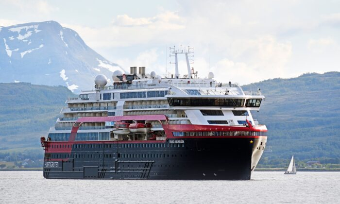 The MS Roald Amundsen cruise ship, the first of the new hybrid-powered expedition ships in Hurtigruten's fleet, arrives at Tromsoe, northern Norway, on July 3, 2019. (Rune Stoltz Bertinussen /NTB Scanpix/AFP via Getty Images)
