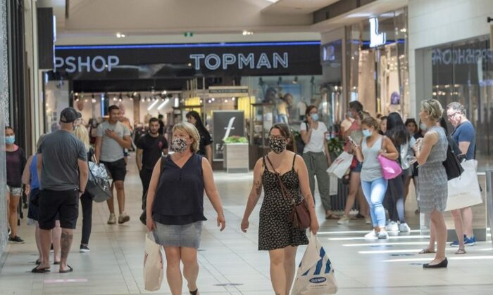 Shoppers walk through Carrefour Laval shopping centre as malls across Quebec reopened amid the COVID-19 pandemic, in Laval, Quebec, on June 19, 2020. (Ryan Remiorz/The Canadian Press)