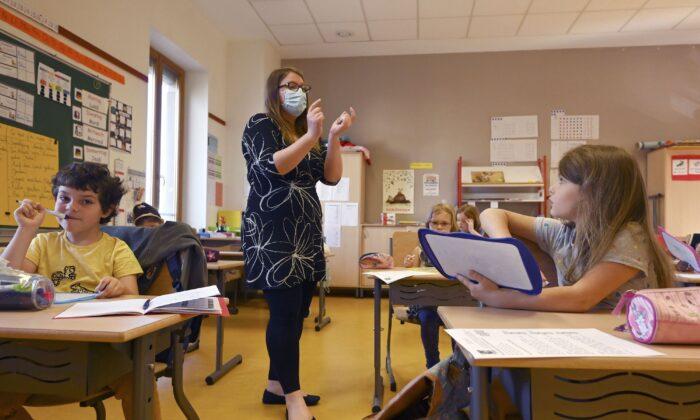 A teacher gives a lesson to the pupils at the Ziegelau elementary school in Strasbourg, France on June 22, 2020. (Frederick Florin/AFP via Getty Images)