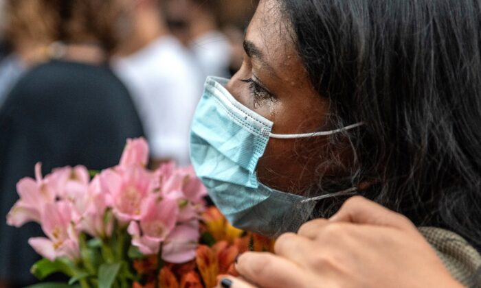 An attendee cries at a vigil for Garrett Foster in downtown Austin, Texas on July 26, 2020. (Sergio Flores/Getty Images)