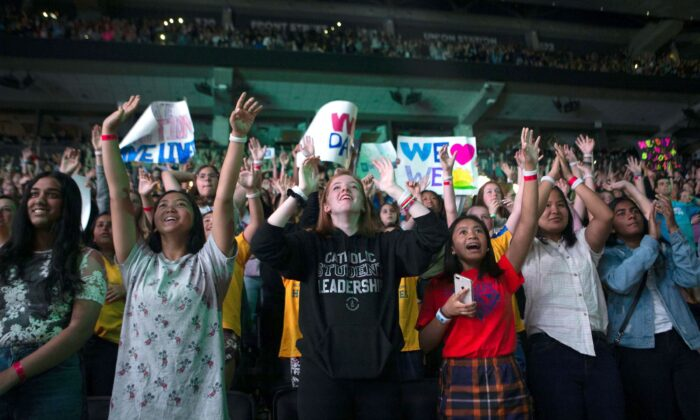 The crowd reacts during WE Day in Toronto on Sept. 19, 2019. (The Canadian Press/Chris Young)