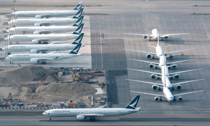 Cathay Pacific aircraft are seen parked on the tarmac at the airport, following the outbreak of the new coronavirus, in Hong Kong, China March 5, 2020.  (Tyrone Siu/Reuters, File Photo)
