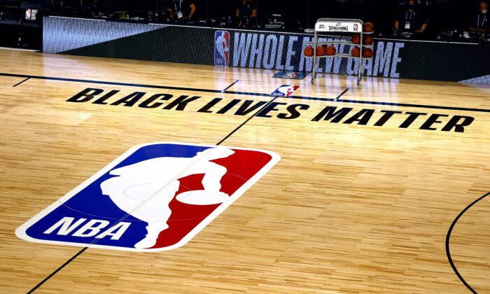 An overview of the basketball court shows the NBA logo and Black Lives Matter before the start of a game at HP Field House at ESPN Wide World of Sports Complex in Lake Buena Vista, Fla., on Aug. 1, 2020. (Kevin C. Cox/Getty Images)
