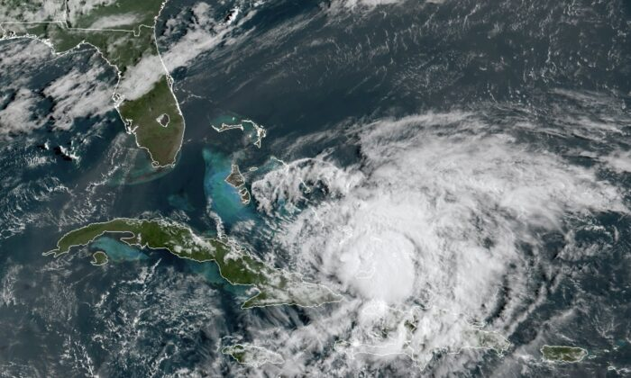 In this GOES-16 satellite image taken Friday, July 31, 2020, at 8:40 a.m. EDT., and provided by NOAA, Hurricane Isaias churns in the Caribbean. (NOAA via AP)