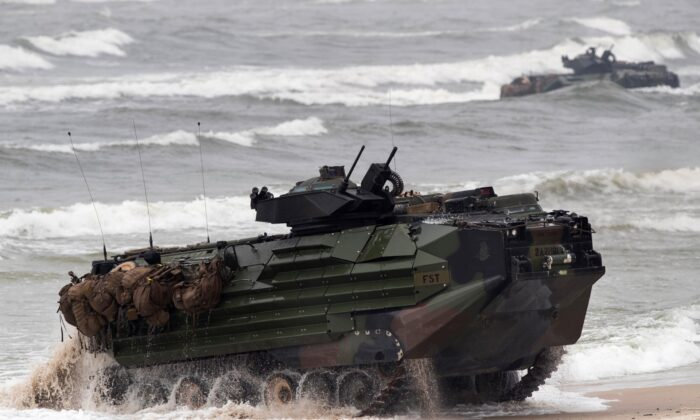 A U.S. Marine amphibious assault vehicle takes part in a landing operation during a military at the Baltic Sea near Vilnius, Lithuania, on June 4, 2018. (Mindaugas Kulbis/ File/AP Photo)