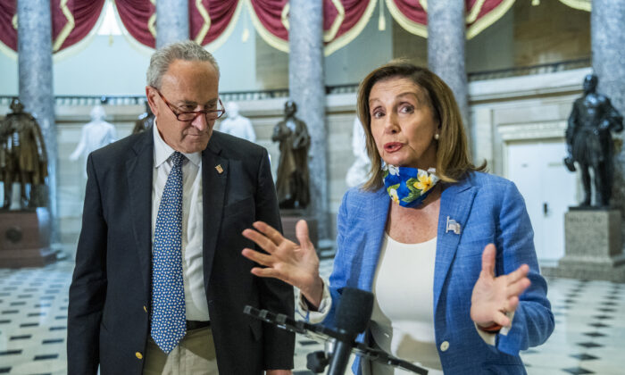 House Speaker Nancy Pelosi (D-Calif.), with Senate Minority Leader Chuck Schumer (D-N.Y.), speaks to reporters at the Capitol in Washington on Aug. 1, 2020. (Manuel Balce Ceneta/AP Photo)