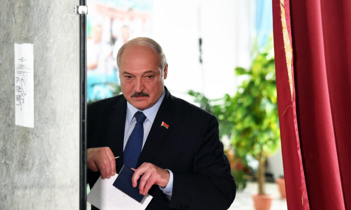 Belarus' President Alexander Lukashenko votes at a polling station during the presidential election in Minsk on Aug. 9, 2020. ( Sergei Gapon/POOL/AFP via Getty Images)