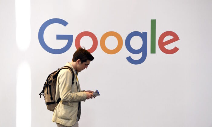 A man walks past the Google logo in Paris, in this file photo. (ALAIN JOCARD/AFP via Getty Images)