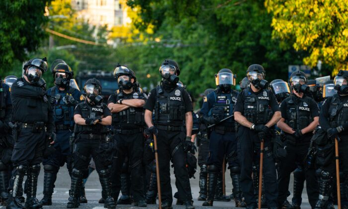 Police block a road during protests near the Seattle Police East Precinct in Seattle, Wash., on July 26, 2020. (David Ryder/Getty Images)