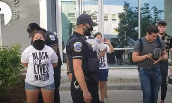 A Student for Life team member, left, is arrested by Metropolitan Police Department officers in Washington on Aug. 1, 2020. (Used With Permission of Students for Life of America)