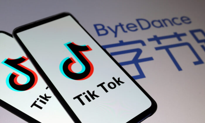 TikTok logos are seen on smartphones in front of a displayed ByteDance logo in a file illustration picture. (Dado Ruvic/Illustration/Reuters)