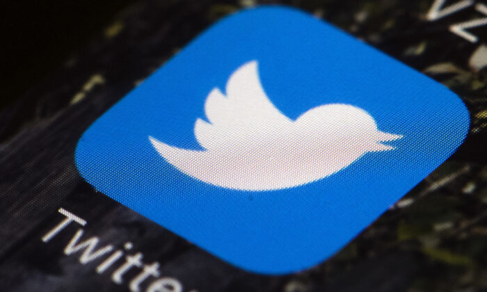 A Twitter app icon on a cell phone in a file photo. (Matt Rourke/AP Photo)