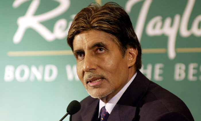 Bollywood star Amitabh Bachchan answers questions following the announcement that he would become the new brand ambassador for luxury textiles manufacturer 'Reid And Taylor', in Bombay, on July 16, 2003. (Sebastian D'Souza/AFP via Getty Images)